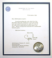 the coin that JFK was to toss 50 yrs ago