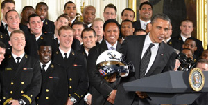 President Obama accepts Navy Midshipmen's helmet